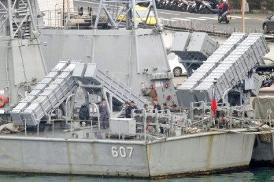Navy personnel stand next to missile launchers while inspecting a frigate at the Keelung navy base yesterday.  Photo: AFP
