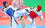 《TAIPEI TIMES 焦點》 Huang claims gold in taekwondo