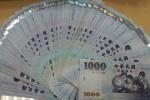 出口商月底拋匯 新台幣走升