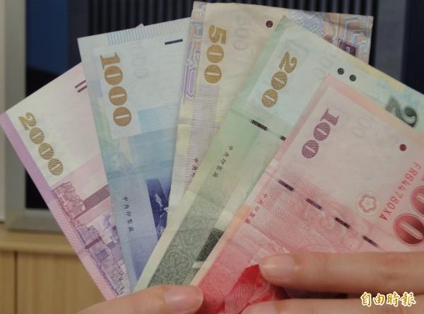 今日新台幣以30.219元兌1美元開出,最高30.170元,最低30.219元,午盤暫收30.182元,升值3.1分。(記者吳佳蓉攝)