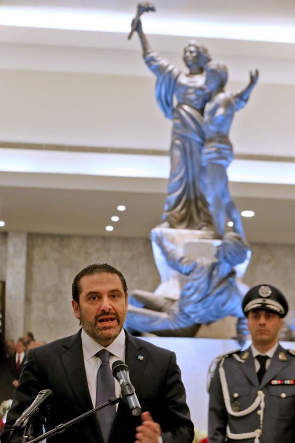 滯留海外近3週的黎巴嫩哈里里22日在總統府告訴媒體,表示將暫緩辭職。(法新社)