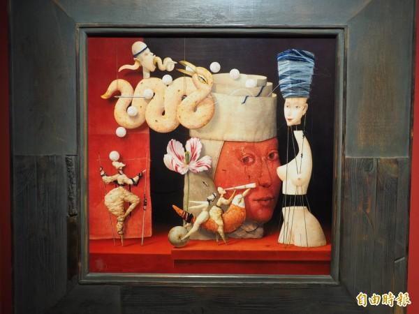 不劃地線阻隔,茲德涅克.揚達的蛋彩畫作內容十分熱鬧。(記者陳鳳麗攝)