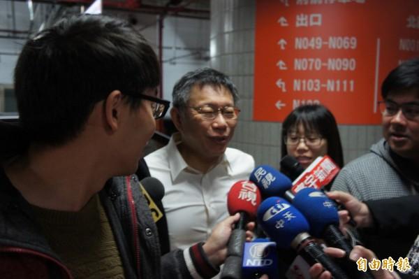 台北市長柯文哲今天上班再次遲到。(記者黃建豪攝)