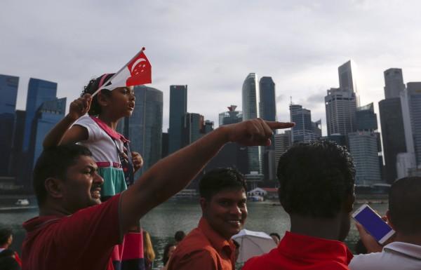 新加坡國民慶祝國慶日。(歐新社)