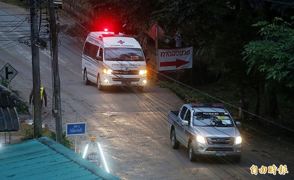 One of two ambulances yesterday leave the Tham Luang cave area in northern Thailand hours after an operation began to rescue trapped youth soccer players and their coach, in Mae Sai, Chiang Rai Province.