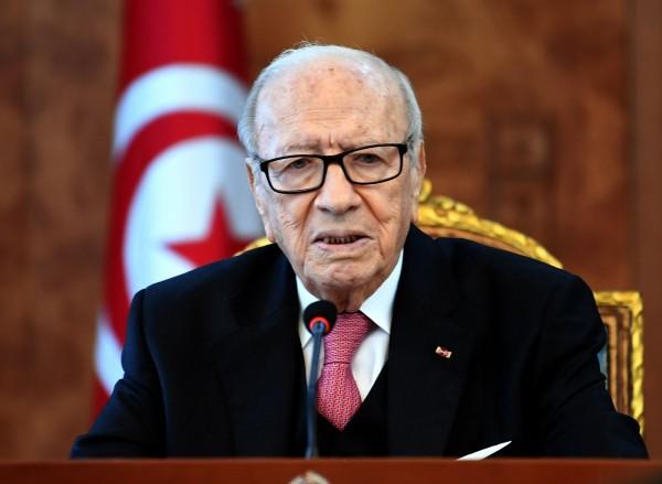 突尼西亞政府實施撙節措施引發國內動亂,當局昨日宣布改革,將向貧困國民增加補助及改善全國醫療保健。圖為突尼西亞總統艾塞布西。(法新社)