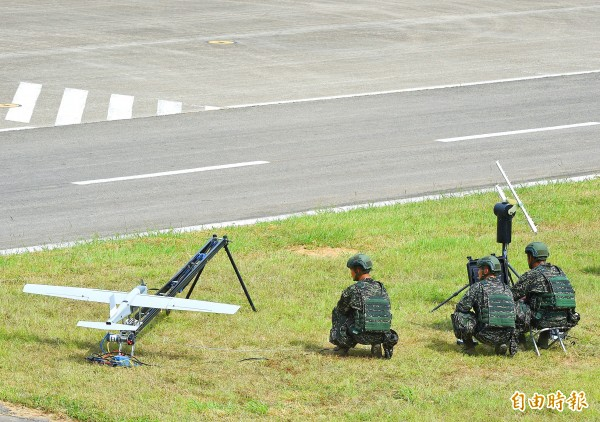 People taking part in a military exercise in Taipei on Thursday last week prepare to launch a drone developed by National Chung-Shan Institute of Science and Technology. Photo: Liu Hsin-de, Taipei Times