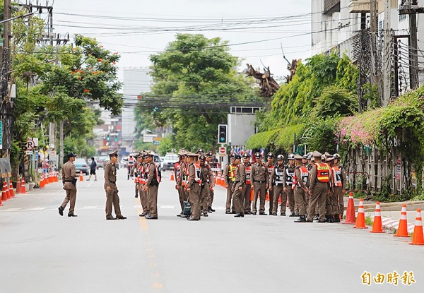 Police are deployed yesterday ahead of the arrival of the rescued soccer players and their assistant coach at a road outside the hospital in Chiang Rai Province, Thailand.