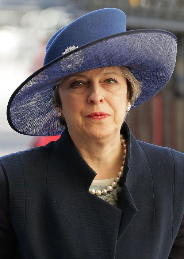 英國首相梅伊日前表示,將在本月底正式展開脫歐程序。(法新社)
