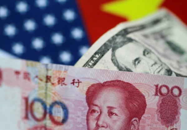 中國長久侵犯美國的智慧財產權,川普政府估計美國每年經濟損失高達6000億美元,美國總統川普將於週一簽署備忘錄,將對中展301條款調查。(彭博檔案照)
