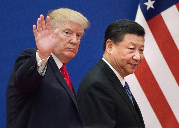 美國政府的多個部門,準備在本週公布有關中國持續竊取美國商業秘密和高級技術。(法新社)