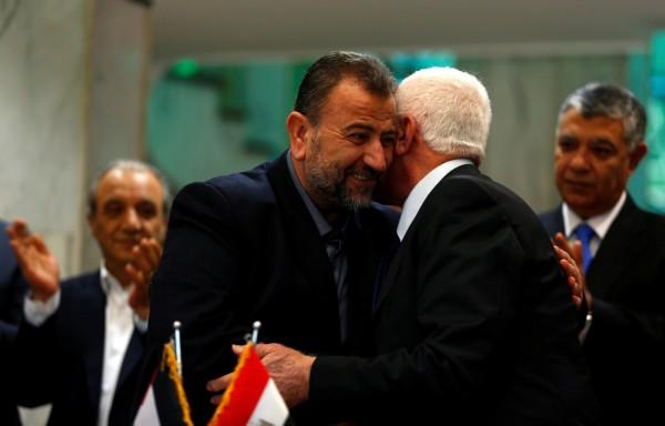 巴勒斯坦的敵對派系法塔組織(Fatah)和哈瑪斯(Hamas),週四簽署終結10年分裂的協議。(路透)