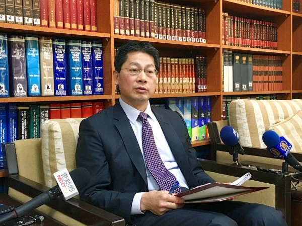 Ministry of Foreign Affairs spokesman Andrew Lee talks to reporters in Taipei yesterday about Papua New Guinea's request for Taiwan to change the name of its representative office. Photo: CNA