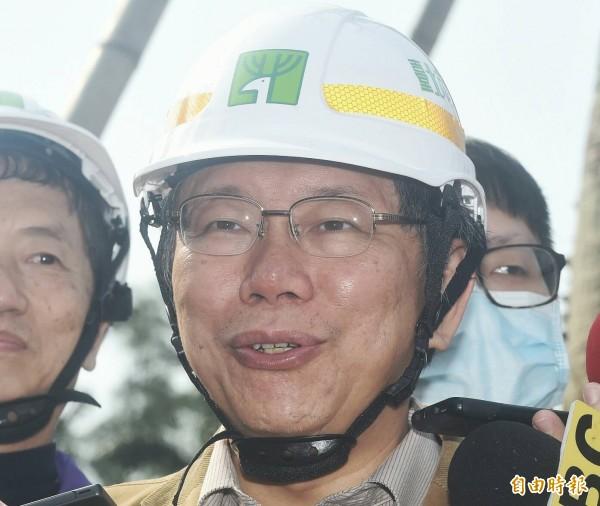 外傳國民黨有意找花蓮縣長傅崑萁來參選北市長,媒體今早詢問台北市長柯文哲對此事的看法,柯表示,等發生後再來煩惱。(記者廖振輝攝)
