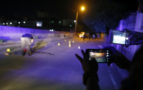 菲國警方的掃毒行動爭議不斷。不少人質疑警方錯殺無辜。(資料照,美聯社)