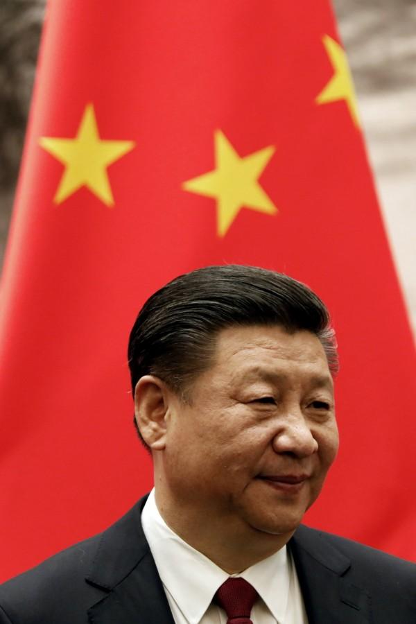 日媒認為,此次習近平在二中原會前特地主持決定送審文件的會議,代表「習思想」可能將正式進入中國憲法。(資料圖,路透)