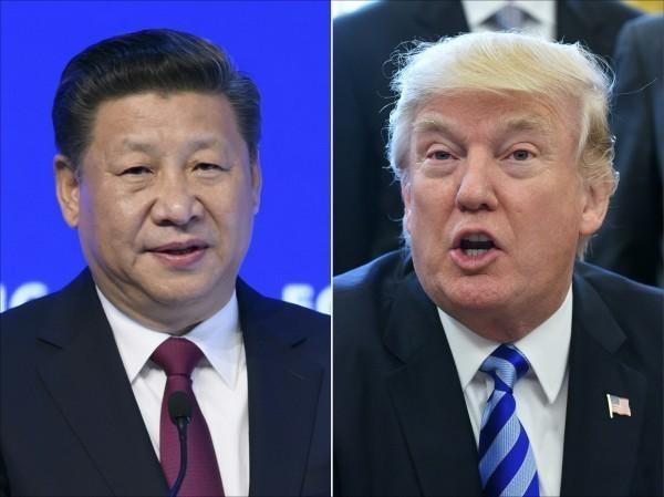 美國總統川普(右)與中國國家主席習近平(左)。(美聯社)