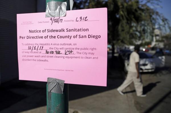 加州當局已採取街道消毒以及廣設洗手站等措施,同時也緊急購入更多疫苗,希望能遏制疫情。(美聯社)