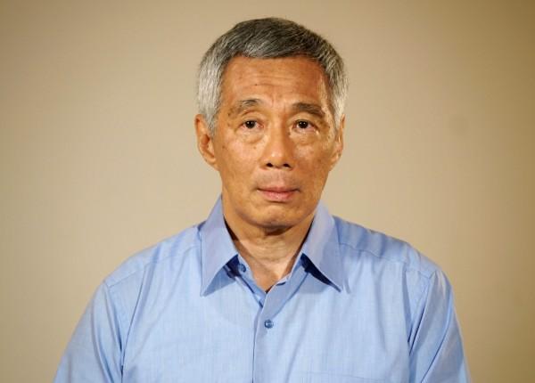 新加坡第一家庭鬧內鬨,總理李顯龍與妹妹李瑋玲及弟弟李顯揚為亡父李光耀故居拆除爭議爆發糾紛。週一晚間,李顯龍為傷害國家聲譽向國民道歉。(法新社)