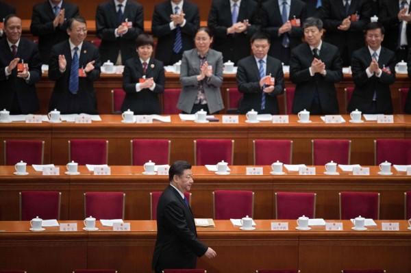 中國國務院今天公布改革方案,將正部級機構將減少8個、副部級機構減少7個,讓部分金融、市場和企業監管部門合併。圖為中國國家主席習近平。(法新社)