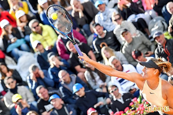 Maria Sharapova returns to Ashleigh Barty during their first-round women's singles match at the Internazionali BNL d'Italia on Tuesday in Rome. Photo: AFP