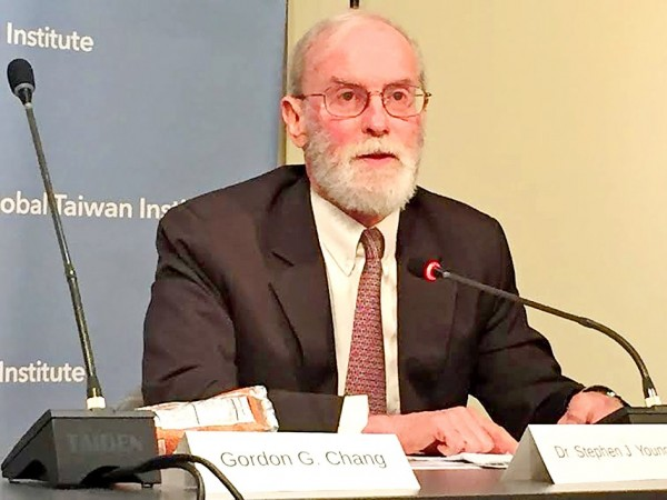 Former American Institute in Taiwan director Stephen Young speaks at a conference in Washington on Wednesday. Photo: Nadia Tsao, Taipei Times