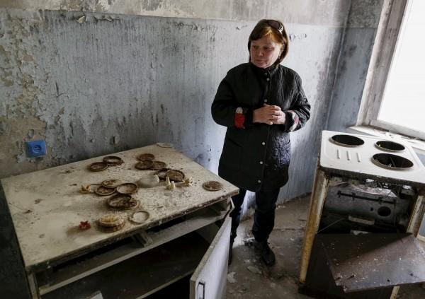 車諾比普里雅特(Pripyat)的居民回鄉後,腦袋裡滿是混亂和犧牲的回憶。(路透)