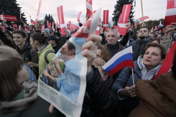 俄羅斯全國共80多個城市向普廷抗議。(美聯社)