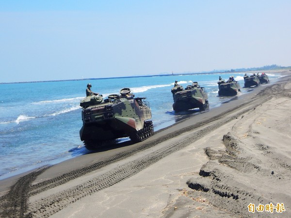 AAV-7 amphibious assault vehicles maneuver along a beach in Kaohsiung on July 20 last year. Photo: Huang Hsu-lei, Taipei Times
