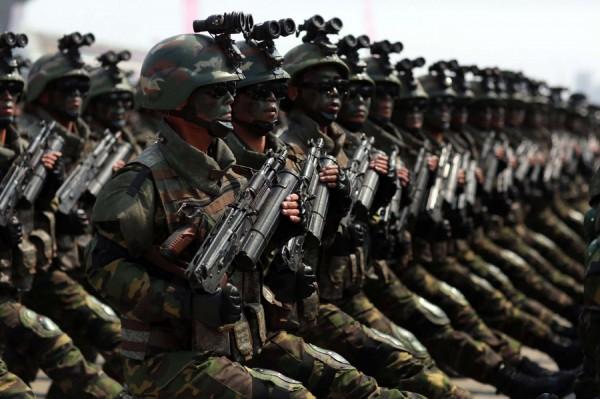 北韓媒體報導,北韓全國有347萬5000人申請加入軍旅。(法新社)