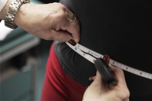 體重過重會增加罹患13種癌症的風險。(美聯社)