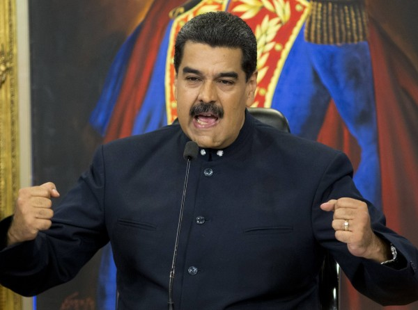 委內瑞拉政府的財務危機日漸擴大,加上國內政治局勢動盪不安,可能面臨倒閉危機。圖為美國總統委國總統馬杜羅(Nicolás Maduro Moros)。(美聯社)