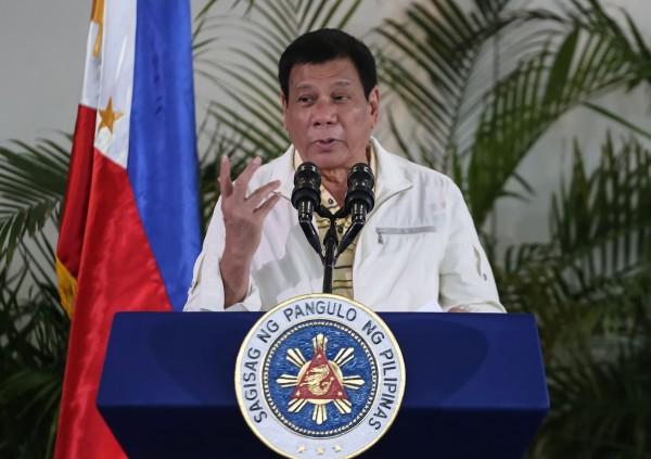 菲律賓總統府馬拉坎南宮5日表示,全國將進入緊急狀態,總統杜特蒂可以調度軍隊支援警察鎮壓所有形式的無法紀暴力行為。(法新社)