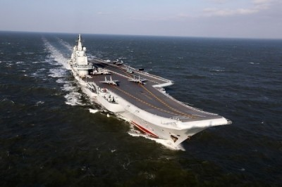 國防部稍早表示,遼寧號航艦編隊持續在中國沿海向北航行,預判明日清晨脫離台海北返歸建。(資料照,法新社)
