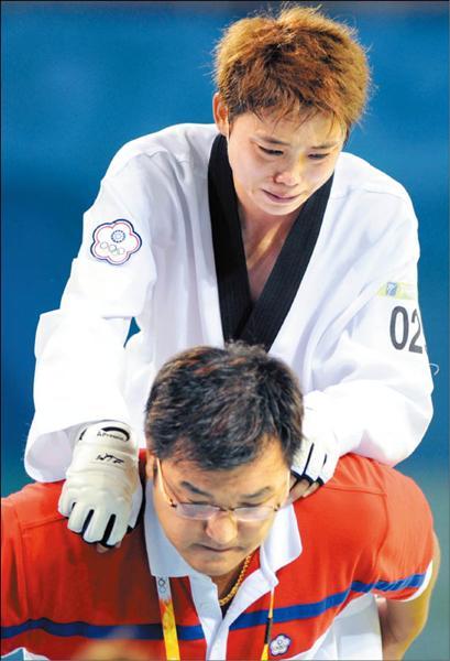 參加奧運是蘇麗文一生的夢想,她說:「在奧運這麼高的殿堂,死掉都值得」,這也是她傷痕累累,仍堅持打死不退的原因。(記者林正堃攝)<br>