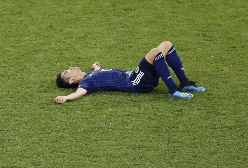 世足賽》不甘心!日本球員心碎跪地、掩面痛哭(圖輯)