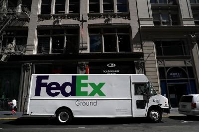 雙利空衝擊 FedEx大砍獲利展望 股價重挫逾9%