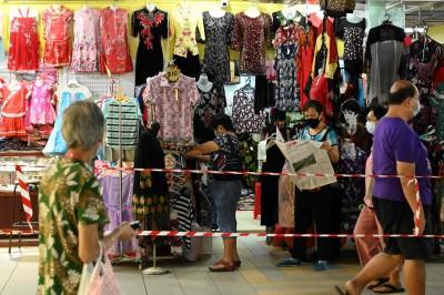 報復性消費解救零售業? 新加坡業者不看好