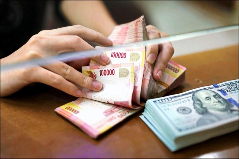 人民幣走強 台幣升2.2分 收30.824元