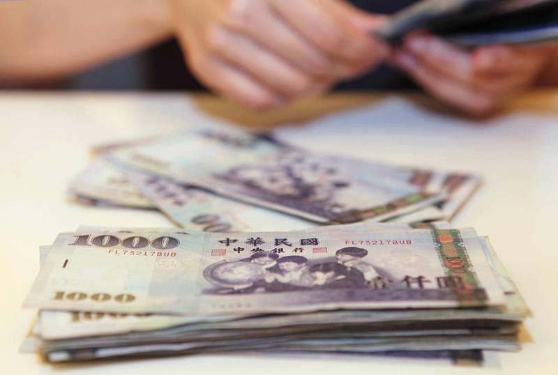 出口商拋匯抵銷外資匯出  新台幣中午暫收29.356元