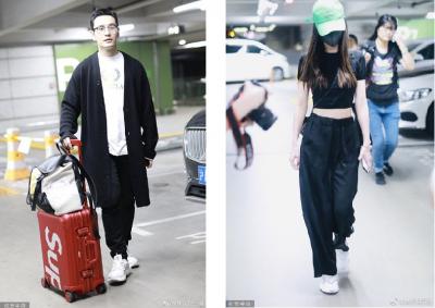 Baby戴綠帽現身機場 黃曉明尷尬說不出話