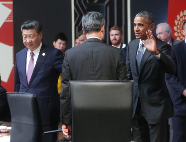 美國總統歐巴馬與香港特首梁振英致意。(中華台北代表團提供)