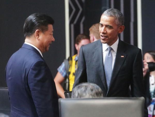 美國總統歐巴馬與中國領導人習近平談話。(中華台北代表團提供)
