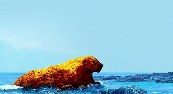 和平島公園在退潮後,會出現隱藏版的奇岩怪石,圖為類似「花豹」的奇岩。(圖為和平島公園提供)