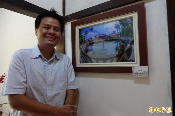 鹿港古都之美攝影比賽金牌得主,是來自雲林的鄭有益,用魚眼拍下文武廟。(記者劉曉欣攝)