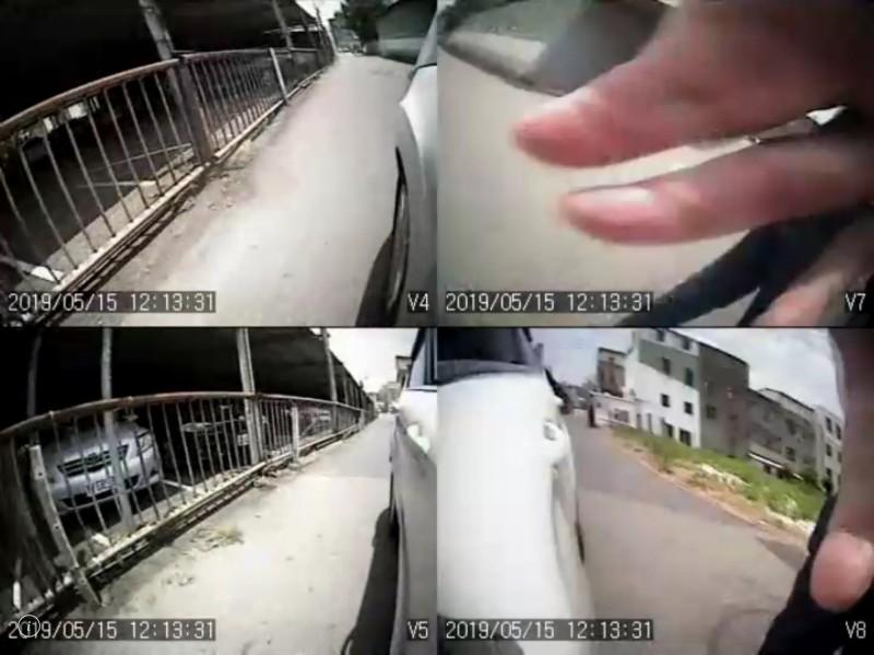 彰化市街頭出現進階版假車禍、真詐財的案例,「伸手伯」拍打路過車輛。(圖擷取自目擊者行車影像記錄器提供畫面)