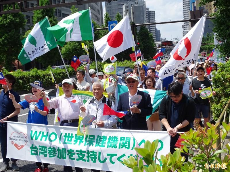 日本僑界19日舉辦遊行,呼籲全球支持台灣參與世界衛生大會(WHA)。(記者林翠儀攝)