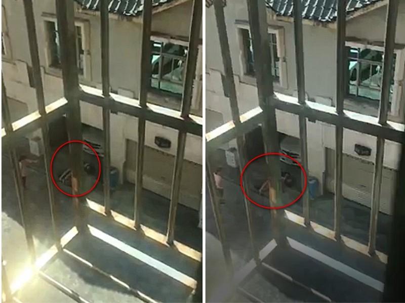 民眾拍下影片,就見劉女如喪般倒在探索汽車旅館1樓,並全身抽搐。(記者徐聖倫翻攝)