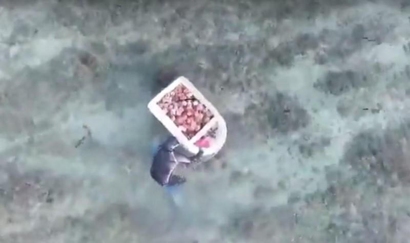 盜採海膽不要以為神不知鬼不覺,小心空拍機就在上空蒐證。(澎湖縣農漁局提供)