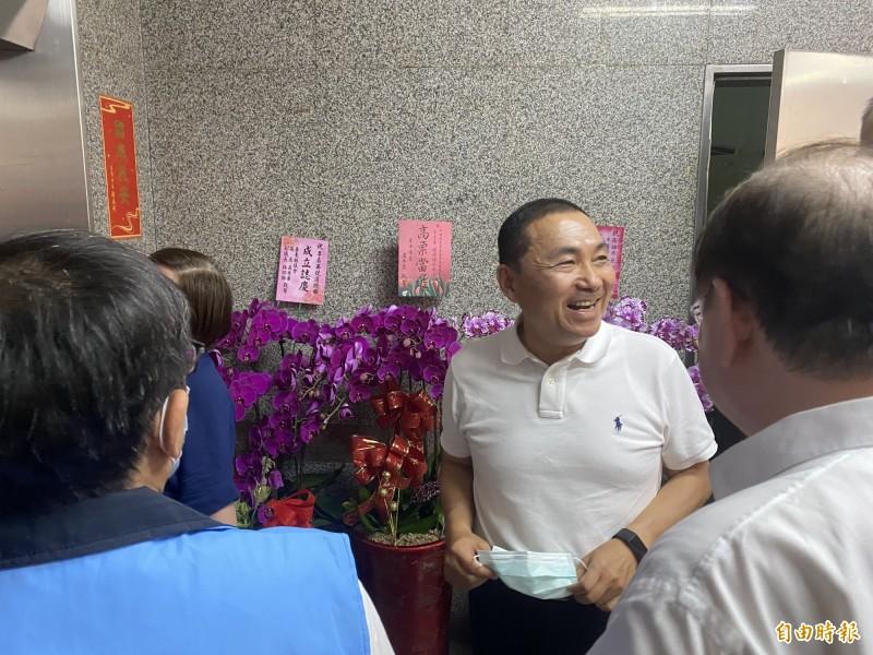 新北市長侯友宜抵達李眉蓁競選總部。(記者黃旭磊攝)
